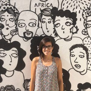 Portrait of Sara Fratini in front of one of her murals